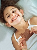 Little Girl with Chocolate on Face and Hands