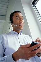 Businessman Using Personal Digital Assistant