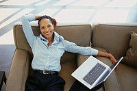 Smiling Businesswoman with Laptop