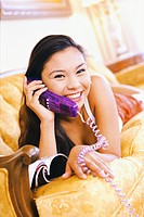 Smiling Young Woman Talking on Telephone