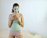 Young Woman Wearing Facial Mask