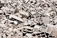 pile of broken grey bricks