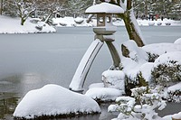 A snow covered stone lantern in Kenrokuen Garden