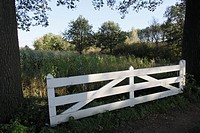 White gate in farm landscape, The Netherlands