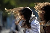 women, hair blowing in the wind