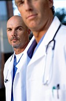 Close up portrait of serious doctors in lab coats