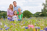Portrait of smiling family in wildflower field