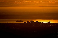 View of downtown Anchorage and a departing cruise ship in Cook Inlet with the Alaska Range in the background at Sunset, Southcentral Alaska, Summer