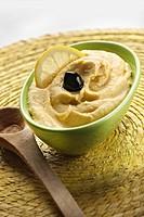 Hummus with a kalamata olive
