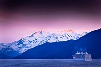Carnival Cruise Spirit sailing through Lynn Canal at sunset, near Haines, Inside Passage, Southeast Alaska, Summer