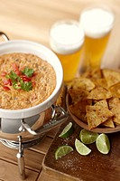 Salsa con queso dip with tortilla chips and beer Mexico