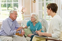 Nursing assistant talking with seniors in Nursing home