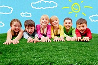 Group of happy children lying on a grass and stretching their hands