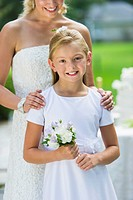 Bride with flower girl 10_11 at wedding reception