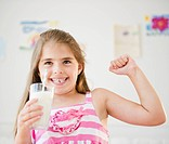 Girl  6_7 drinking milk and showing strength