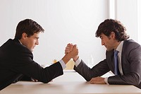 Two business men armwrestling