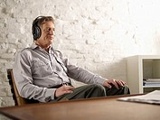Germany, Hamburg, Senior man listening music