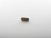 Single pill on white background