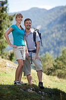 Germany, Upper Bavaria, Couple hiking, smiling
