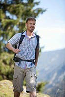 Germany, Upper Bavaria, Mid adult man hiking, smiling