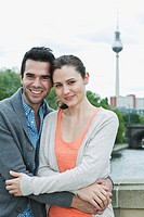 Germany, Berlin, Couple standing on bridge, portrait, smiling