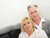 Germany, Hamburg, Couple on sofa, portrait