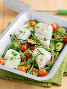 Fish bake with cherry tomatoes, courgettes and green beans