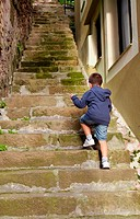Child climbing stairs, Pasai Donibane, Pasajes de San Juan, Gipuzkoa, Basque Country, Spain