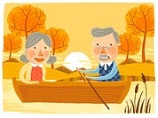 Elderly couple sailing Boat