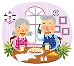 Elderly couple drinking together cup of tea