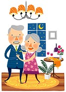 Elderly couple dancing together
