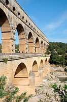 Ancient Roman aqueduct bridge from 1st century AD called Pont du Gard over Gard River near Remoulins, Gard departement in France
