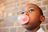 Boy blowing bubble with chewing gum, Johannesburg, Gauteng Province, South Africa