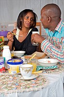 Kenyan couple sharing breakfast, Nairobi, Kenya