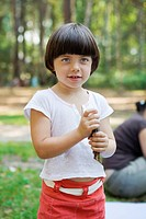 little cute pensive girl five years old standing on the park