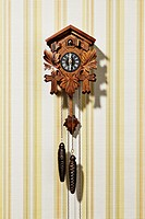 Vintage clock on striped wall