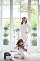 Girls with violin and fencing gear