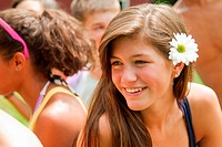 Portrait of a teenage girl with a flower in her hair