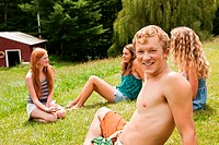 Friends relaxing together on a lawn in summer