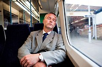 Commuter asleep on train