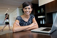 Portrait of businesswoman using laptop