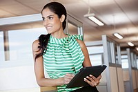 Portrait of young businesswoman in office cubicle