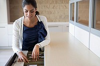 Young woman checking files in office