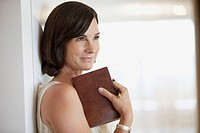 Portrait of smiling businesswoman holding book