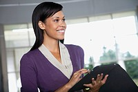 Portrait of businesswoman using digital tablet