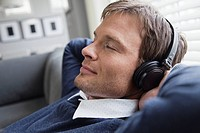 Man with headphones relaxing at home