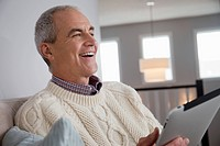 Smiling middle_aged man using digital tablet