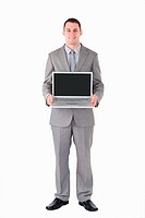 Portrait of a businessman holding a laptop against a white background