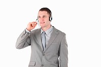 Businessman using a headset against a white background