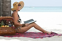 Smiling Woman With Electronic Book on Beach, Aruba